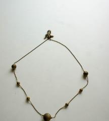 ogrlica z zlatimi kroglicami