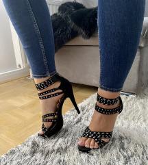 Sandali z visoko peto