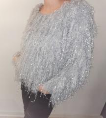 Nov extravaganten pulover
