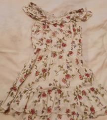 Rožasta obleka 38