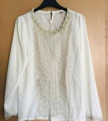 Umazano bela bluza