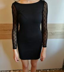 Črna obleka s prosojnimi rokavi s pikami