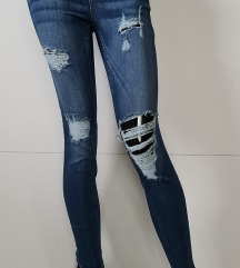 Skinny ripped jeans S