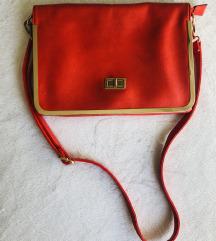 Rdeča ročna torbica
