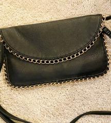 Manjša črna torbica z zlatim robom