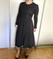 Črna obleka s tilom