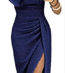 Elegantna svetlikajoča modra obleka