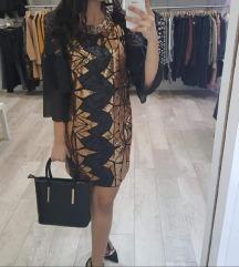 Nova obleka s črnimi in zlatimi luskami
