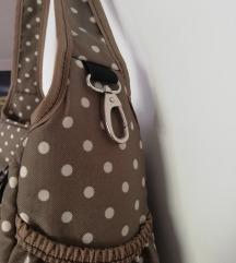 Pikasta previjalna torba