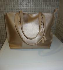 Večja srebrna torba torbica