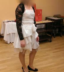 Bela svecana oblekica z svetlecimi detajli