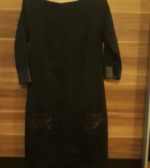 Crna obleka z usnjenimi dodatki