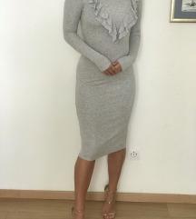 Siva oprijeta obleka z volancki