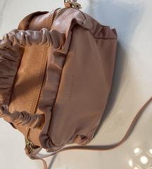Cocinelle torbica kot nova