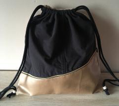 nov črno-zlat nahrbtnik