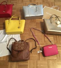 Michael Kors torbice in nahrbtnik