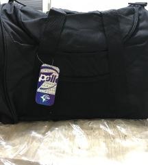 Manjsa potovalna torba