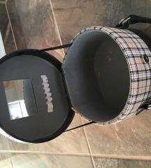 Okrogla toaletna torbica z ogledalom