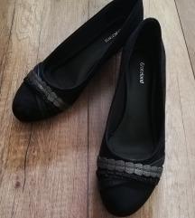 Črni čevlji s polno petko