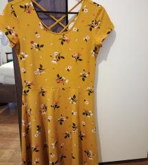 Rumena oblekica z rožicami