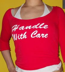 'Handle with care' majca