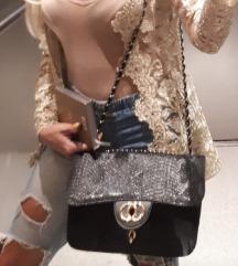 Črna torbica kačasta