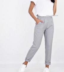 Sive elegantne dolge hlače