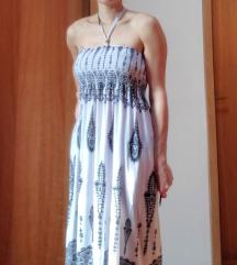 Bela obleka z vzorcem, možno tudi kot krilo