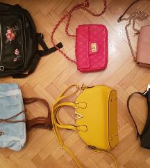 Torbe denarnice ruksaki