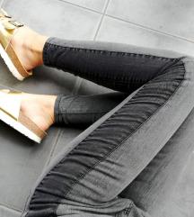 ZNIŽ.Črne stripe jeans hlače
