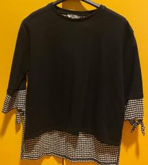 Črna majica s črno-belimi kvadratki