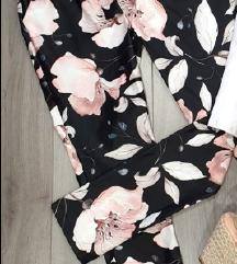 Nove črno-rožaste hlače
