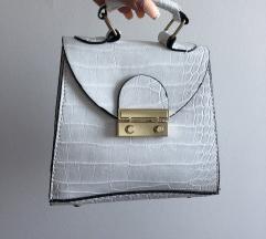 Nova bela torbica