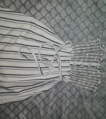 Oblekca s
