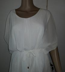 Bela obleka z etiketo