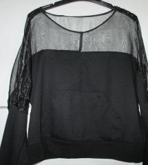 Črni pulover s prosojnimi rameni