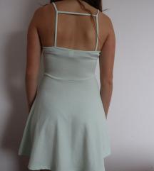 Turkizna oblekica z odprtim hrbtom