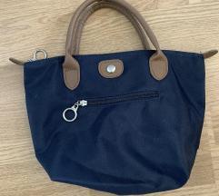 Zelo ugodna torbica!