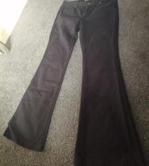 Črne jeans hlače na zvonec Promod