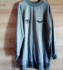 Nov pulover z etiketo
