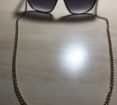Sončna očala z zlato verigico