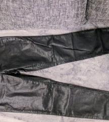 Črne jeggings hlače svetlečega videza
