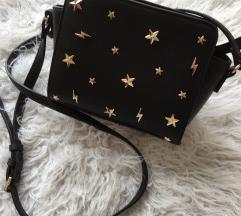 Mala črna torbica z zlatimi zvezdicami