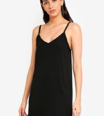 Ragazza črna obleka