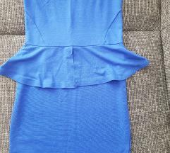 Peplum oblekca