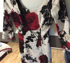 Obleka z rdecimi vrtnicami