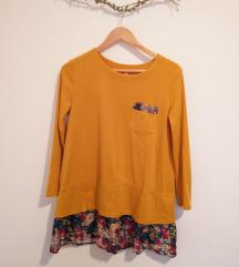 Rumena obleka z rožastimi detajli