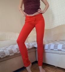 Oranžne jeans hlače