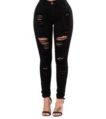Moderne natrgane črne hlače
