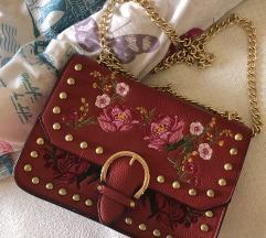 Ženska torbica z netki